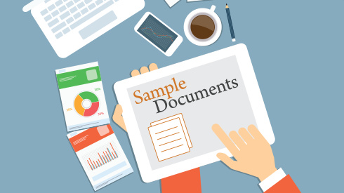 person holding table looking at sample documents